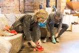 Courtney Ch'ng Lancaster and Kyra Harper trying on John Fluevog shoes. Photo: Aleksandar Antonijevic