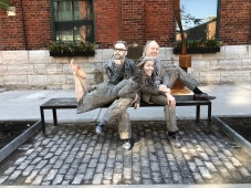 Jakob Ehman, Laura Condlln and Diego Matamoros lounging in the Distillery District. Photo: Jason Carlos